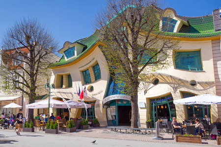 crooked: The Crooked house on the main street of Monte Cassino in Sopot, Poland Editorial