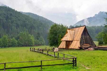 giewont: Wooden hut under Tatra mountains in Zakopane, Poland Stock Photo