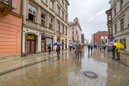 main market: Rainy day on the main market square of the Old Town in Krakow
