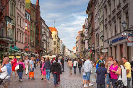 old people: People walking in the old town of Torun Editorial
