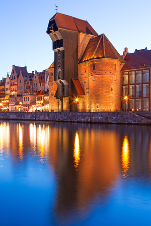 architectural lighting design: Old town of Gdansk with ancient crane at night, Poland Stock Photo