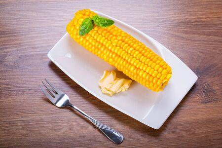 corncob: Cooked corncob on the plate