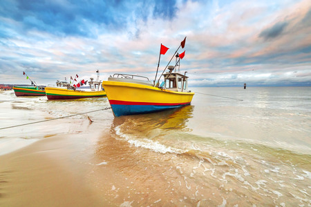 Fishing boats on the beach of Baltic Sea in Poland 版權商用圖片 - 59458637