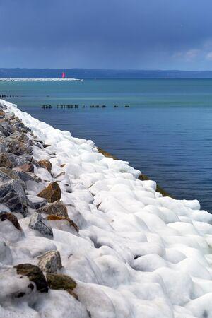 Icy Baltic sea coast at winter time, Poland Stock Photo
