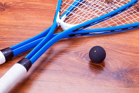 Raquet: Close-up of squash rackets and ball