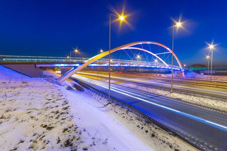 bypass: Footpath bridge over bypass of Gdansk at night, Poland