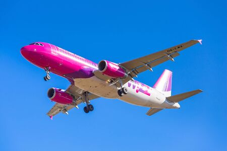 plane landing: Wizz air plane landing on Lech Walesa Airport in Gdansk Editorial