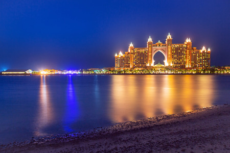 Atlantis hotel iluminated at night in Dubai, UAE