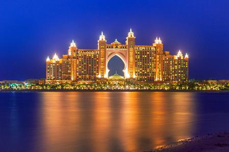 Atlantis hotel iluminated at night in Dubai, UAE