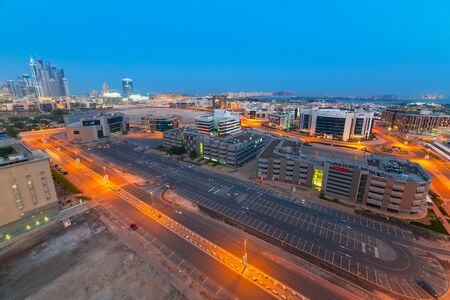 architectural firm: Technology park of Dubai Internet City at night Editorial