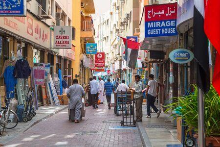 sidewalk sale: People on the street of Deira area in Dubai Editorial
