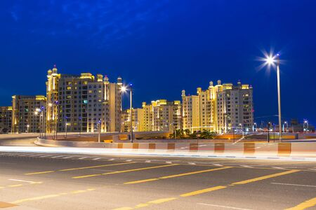 Road to the Palm Jumeirah island in Dubai at night, UAE