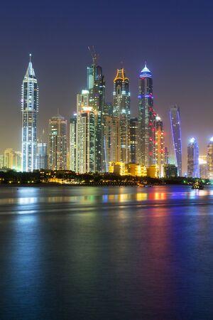 famous industries: Skyscrapers of Dubai Marina at night Editorial
