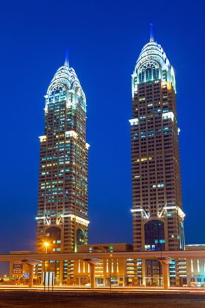 architectural firm: The Al Kazim Towers in Dubai Media City at night