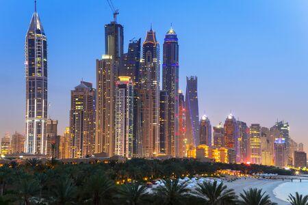 famous industries: Cityscape of Dubai at night, United Arab Emirates