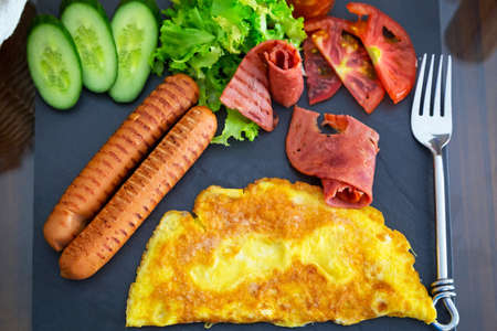 english cucumber: Scrambled eggs, sausages and bacon with salad breakfast