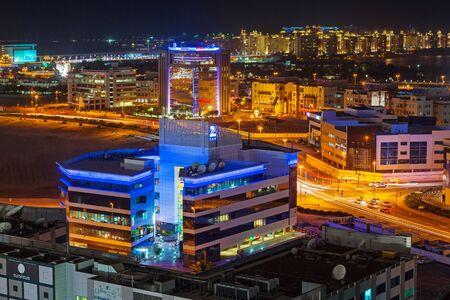 architectural firm: Technology park of Dubai Internet City at dusk