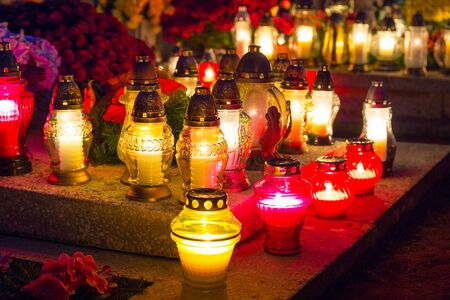 all saints day: Cemetery at night with colourful candles for All Saints Day in Poland Stock Photo