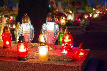 Cemetery at night with colourful candles for All Saints Day in Poland Stock Photo