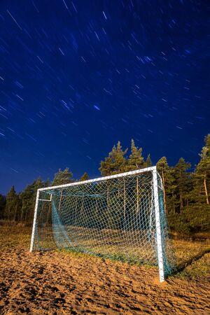 soccer pitch: Soccer pitch under starry sky at night Stock Photo