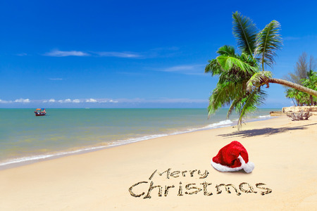 Merry Christmas with santa hat from the tropical beach Stock Photo