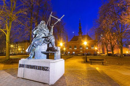 johannes: Monument of astronomer Johannes Hevelius with historical architecture of Gdansk, Poland Stock Photo