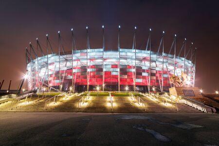 polska monument: National Stadium in Warsaw illuminated at night by national colours, Poland
