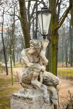 lazienki: Lantern decorated by sculpture of satyr in Lazienki Park (Royal Baths Park) of Warsaw, Poland