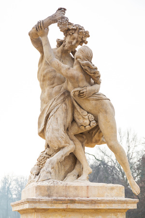 lazienki: Statue of nymph catching grapes from satyrs hand in Lazienki park (Royal Baths park), Warsaw, Poland