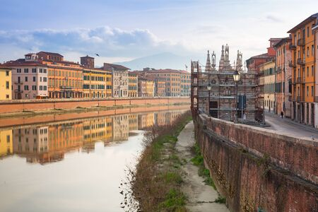 arno: Old town of Pisa with reflection in Arno river, Italy
