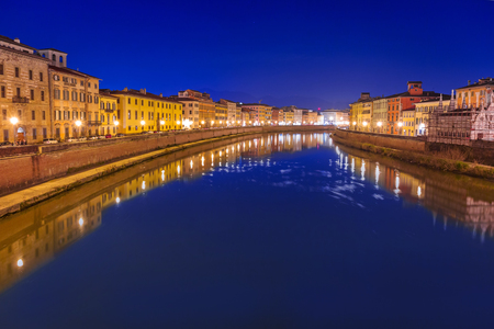 arno: City center of Pisa with reflection in Arno river, Italy