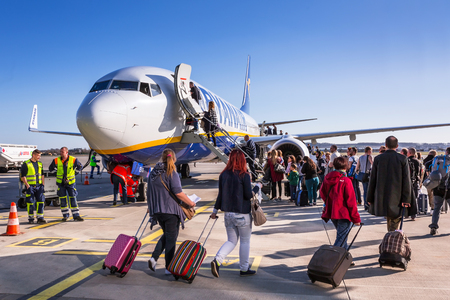 People boarding to Ryanair plane on Lech Walesa Airport in Gdansk Editorial