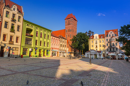 old people: People walking on the old town of Torun, Poland Editorial