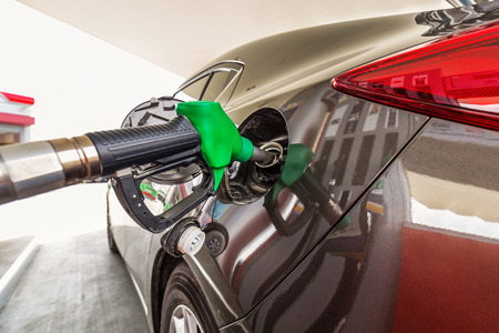 refilling: Refilling car fuel at the gas station