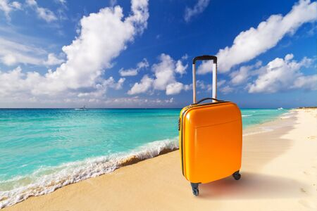 caribbean beach: Summer holidays with baggages on the tropical beach