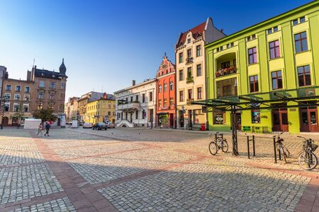 old people: People walking on the old town of Torun, Poland Stock Photo