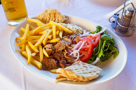 gyros: Gyros with chips on the plate