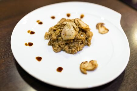cep: Risotto with cep mushrooms on the plate