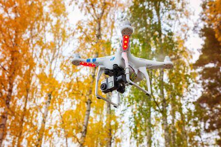 phantom: Flying drone quadcopter Dji Phantom 2 with digital camera Editorial