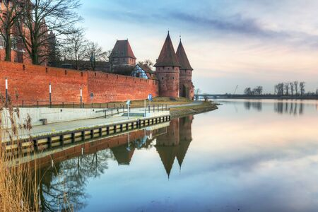 order in: The Castle of the Teutonic Order in Malbork at sunset, Poland Editorial