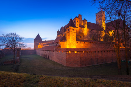 teutonic: The Castle of the Teutonic Order in Malbork at dusk, Poland Editorial