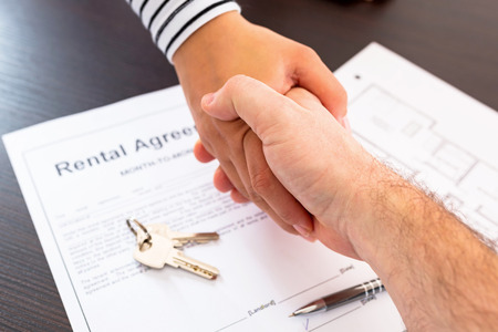 rental: Signing rental agreement contract Stock Photo