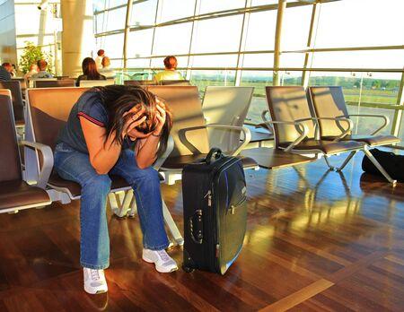 awaiting: Depressed woman awaiting for delayed plane