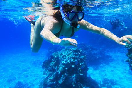 dive trip: Woman snorkeling near Tiran Island in Red Sea