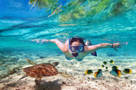 Woman snorkeling in the tropical water