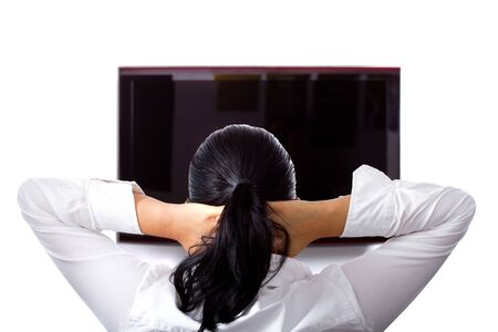 destress: Woman resting hands behind her neck in front of the television
