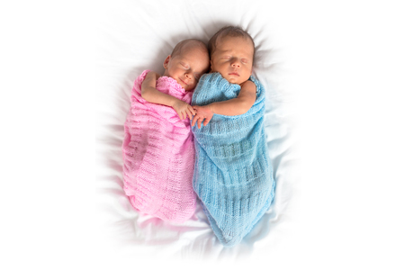 Newborn twins cuddling to sleep Stock Photo