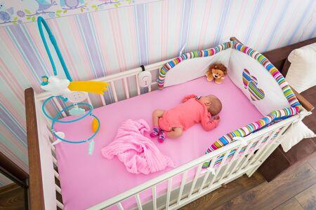 baby crib: Newborn baby sleeping in baby crib