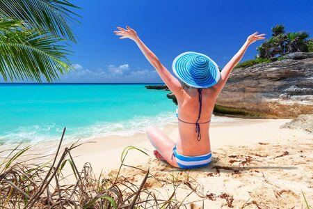 Woman enjoying the sun on the beach of Mexico