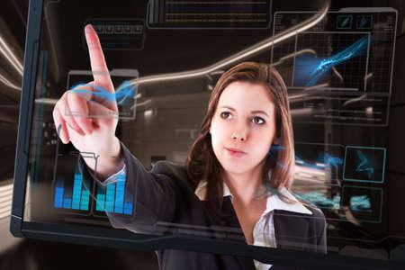 futuristic interior: Beautiful woman with interface in futuristic interior